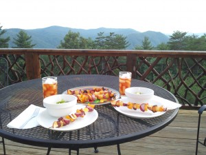 Enjoy a private dinner for two on your secluded deck overlooking the Blue Ridge Mt.
